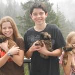 Sam, Eliza, and Leah with Puppies